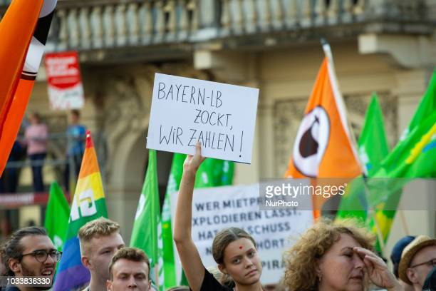 Sign referring to the Bayern LB, GBW and Markus Soeder. Among the police more than 7000 people protested under the motto #Ausspekuliert against too...