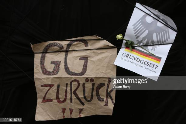 Sign referring to the Grundgesetz, or German constitution known as the basic law, hangs as protesters demonstrate against restrictions on public life...