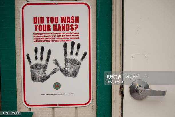 A sign reminding firefighters to wash their hands is seen near a dormitory unit to be used for quarantine of travelers at risk of coronavirus at the...