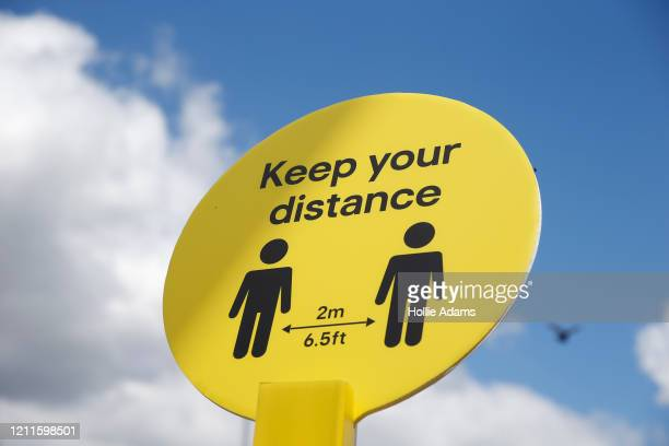 Sign reminding people about social distancing measures is displayed at B&Q Leyton on May 2, 2020 in East London, United Kingdom. British Prime...