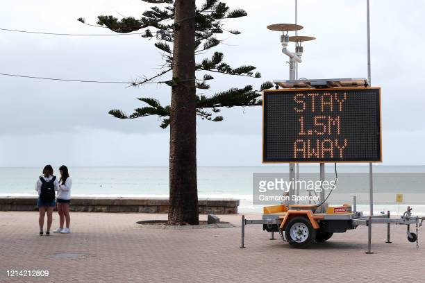 Sign reminding residents and tourists of new social distancing rules is displayed at Manly Beach on March 23, 2020 in Sydney, Australia. From midday...