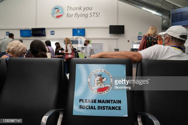 Sign reminding travelers to maintain social distance at Charles M. SchulzSonoma County Airport in Santa Rosa, California, U.S., on Wednesday, April...