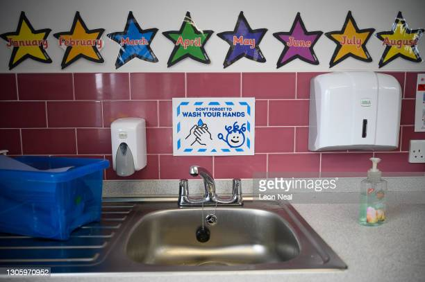 Sign reminds pupils to wash their hands, as classes return to Gamlingay Village Primary on March 08, 2021 near Bedford, United Kingdom. The school,...