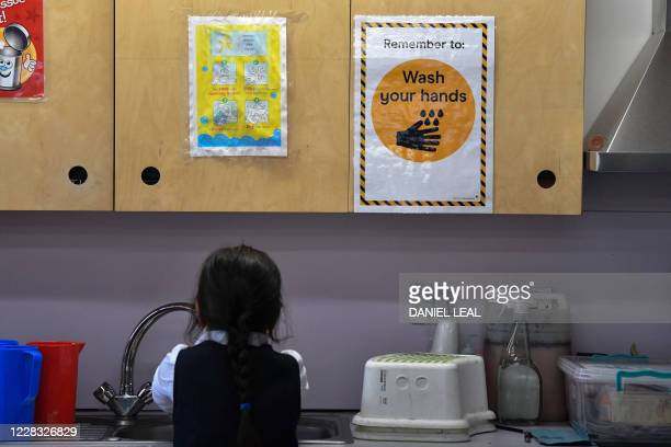 Sign reminds pupils to wash their hands, in a classroom at St Luke's Church of England Primary School in East London on September 3, 2020. - Pupils...