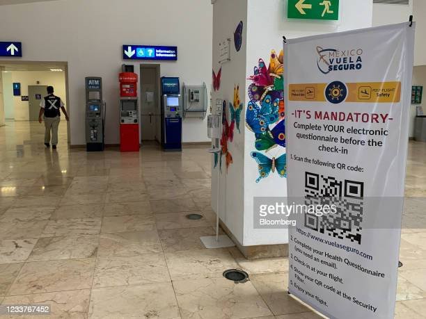 Sign reminds travelers to fill out an electronic Covid-19 health questionnaire before checking-in at Aeropuerto International de Cozumel in San...