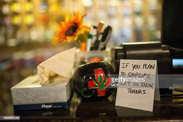 A sign requests that wouldbe shoplifters identify themselves on a small sign seen here in the at Ganja Gourmet in Denver Colorado on April 17 2013