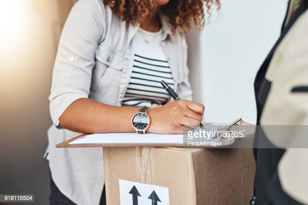 sign right on the dotted line - sending stock photos and pictures