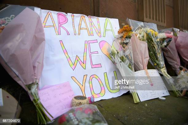 A sign saying 'Ariana we heart you' is displayed amongst flowers left in St Ann Square on Tuesday May 23 2017 in ManchesterEngland At least 22 people...