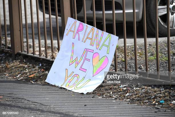 A sign saying 'Ariana we love you' is left in the street on May 23 2017 in Manchester England An explosion occurred at Manchester Arena as concert...