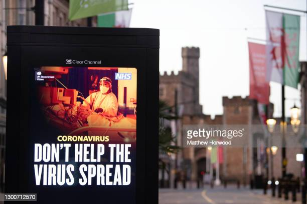 """Sign saying """"don't help the virus spread"""" near Cardiff Castle in the city centre on January 24, 2021 in Cardiff, Wales. Wales went into a Level 4..."""