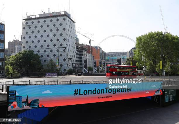 A sign saying London Together on the Bobby Moore Bridge infront of Wembley Stadium on May 07 2020 in London England The UK is continuing with...