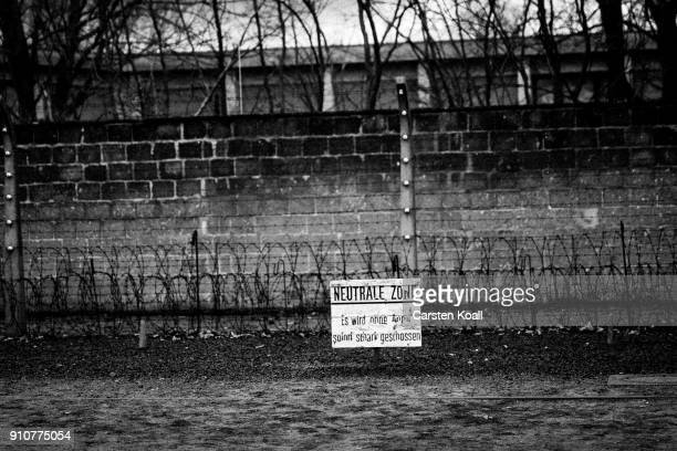 A sign saying 'NEUTRALE ZONE Es wid ohne Anruf sofort scharf geschossen' advices at a barbed wire fence at the Sachsenhausen concentration camp...