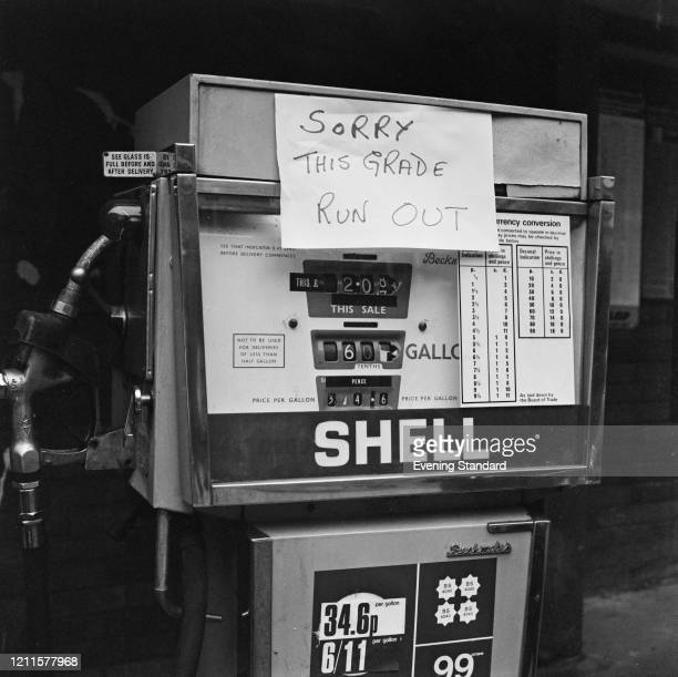 Sign saying 'Sorry, This Grade Run Out' stuck to a four star petrol pump at a Shell service station during a fuel shortage in London on 3rd February...