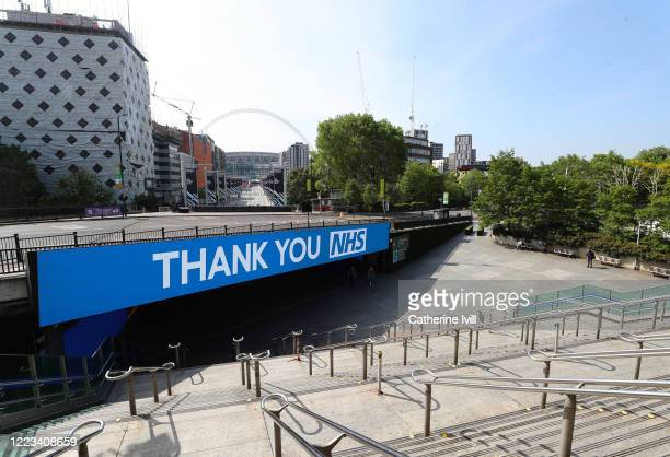 A sign saying Thank You NHS can been seen on the Bobby Moore bridge infront of Wembley Stadium on May 07 2020 in London England The UK is continuing...