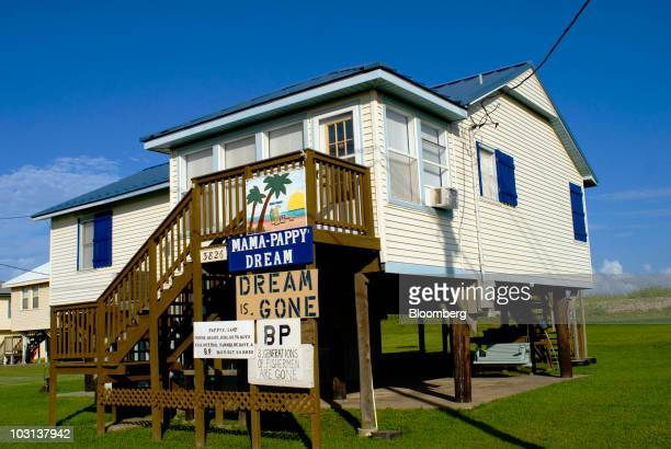A sign saying the Dream is Gone and other signs commenting on BP Plc stand in front of a home in Grand Isle Louisiana US on Tuesday July 27 2010 The...
