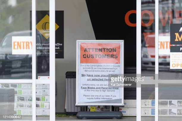 Sign saying We are out of stock of Face Masks and Hand sanitizer is seen at a Mitre 10 hardware shop on March 24, 2020 in Christchurch, New Zealand....