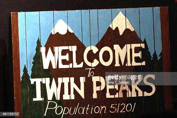 A sign says 'Welcome to Twin Peaks Population 51201 during the sixth annual Twin Peaks UK Festival at Genesis Cinema on October 3 2015 in London...