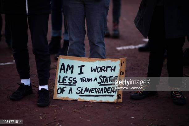 Sign seen on the floor during a protest outside Central Police Station on March 17, 2021 in Cardiff, Wales. Legislation giving police greater power...