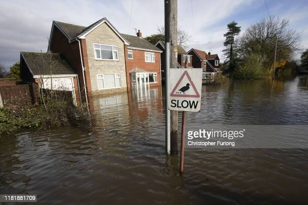 Sign showing a picture of a duck and the word 'slow' is seen as flood water covers the roads in the Fishlake area on November 12, 2019 in Doncaster,...