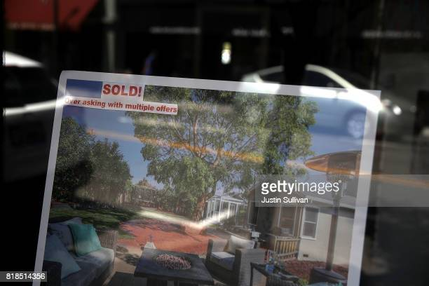 A sign showing a sold home is posted in the window of a real estate office on July 18 2017 in San Anselmo California California is experiencing a...