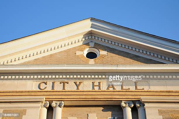 a sign showing city hall on a building  - town hall stock pictures, royalty-free photos & images