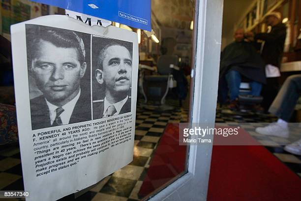 A sign showing pictures of Democratic presidential candidate Barack Obama on the right and Robert F Kennedy slain in 1968 while running for the...