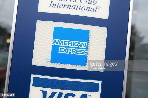 A sign showing the American Express logo is seen outside of a bank November 11 2008 in Des Plaines Illinois American Express won federal approval to...