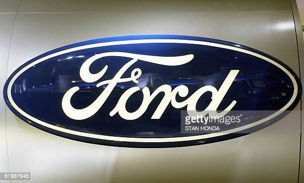 Sign showing the corporate logo for the Ford Motor Company is pictured 11 January 2005 during the North American International Auto Show at Cobo Hall...