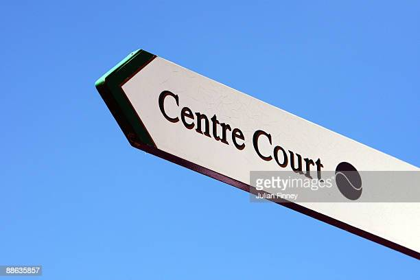 A sign showing the direction of Centre Court is seen during the second day of the Wimbledon Lawn Tennis Championships at the All England Lawn Tennis...
