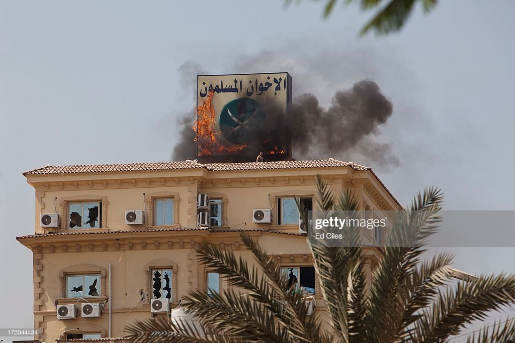 Muslim Brotherhood Head-Quarters Attacked As Anti-Morsi Protests Are Held : News Photo