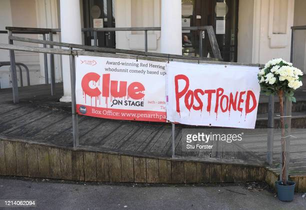 Sign showing the postponement of a stage show at Penarth pier pavilion on March 22, 2020 in Penarth, Wales. Coronavirus has spread to at least 188...