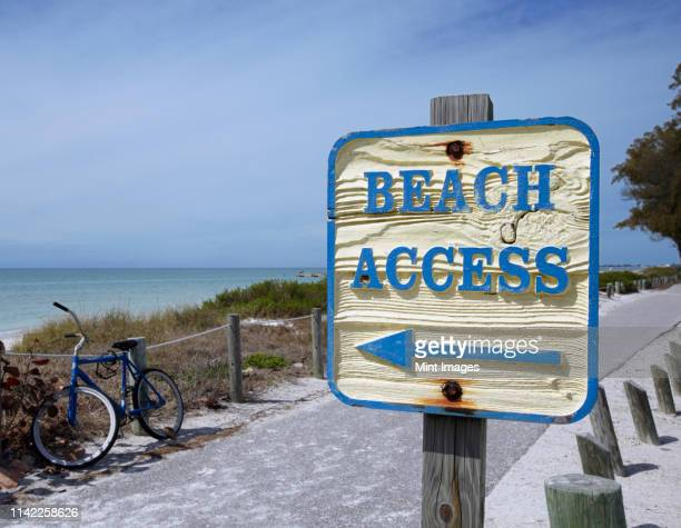 sign showing the way to the beach - bradenton stock pictures, royalty-free photos & images