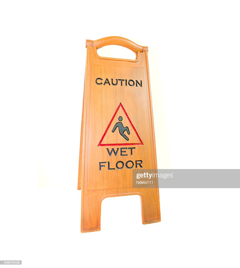 Sign showing warning of caution wet floor : Stock Photo