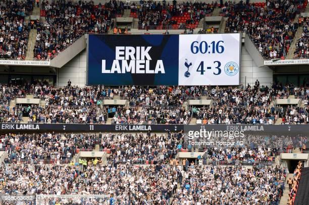 Sign showning the score after Erik Lamela of Tottenham Hostpur scores a hat trick during the Premier League match between Tottenham Hotspur and...