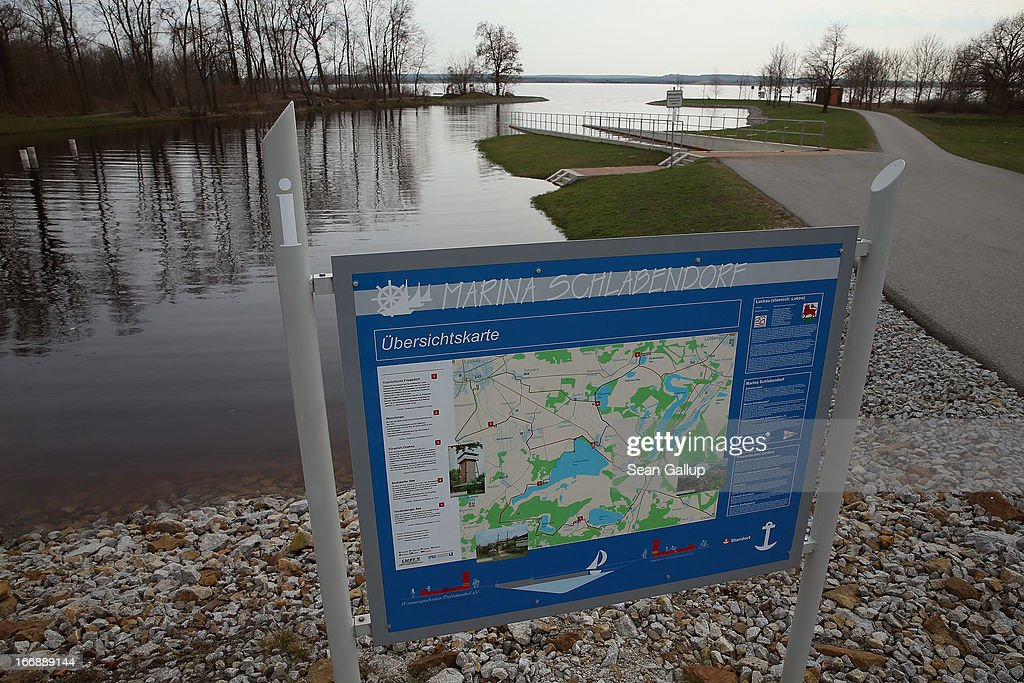 A sign shows a local map at the Schlabendorfer See lake marina near the Spreewald region on April 17, 2013 in Schlabendorf, Germany. Schlabendorfer See is a man-made lake created from the conversion of the former Schlabendorf open-pit coal mine. The lake, because of the mine, is heavily burdened with iron sediment that is inundating the nearby Wudritz creek. Many creeks and small rivers that feed the nearby Spree River have turned a rich orange or brown, sometimes even red, due to the sediments flowing from several former open pit coal mines. The Spreewald is a popular tourist destination known for its network of canals and local tour operators fear the sediment will turn the waters there orange as well, which could seriously impact the tourist seasons. Though the iron sediment is not poisonous, some local farmers claim they have been forced to filter the water they use to irrigate their fields, and many people report the disappearance of fish and other fauna.
