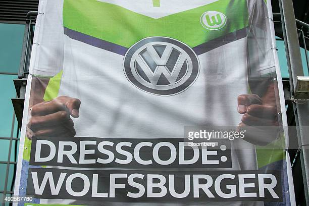 Sign shows a VW sponsored soccer jersey outside the Volkswagen Arena, home of Bundesliga football club VfL Wolfsburg, in Wolfsburg, Germany, on...