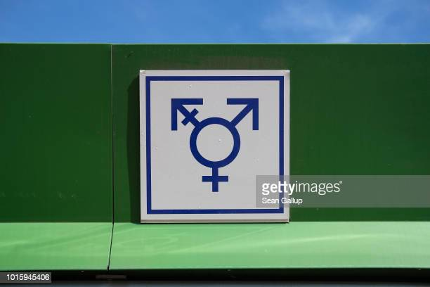 A sign shows facilities for men women and transgender people at a public pool on August 12 2018 in berlin Germany Berlin is known as a city with...
