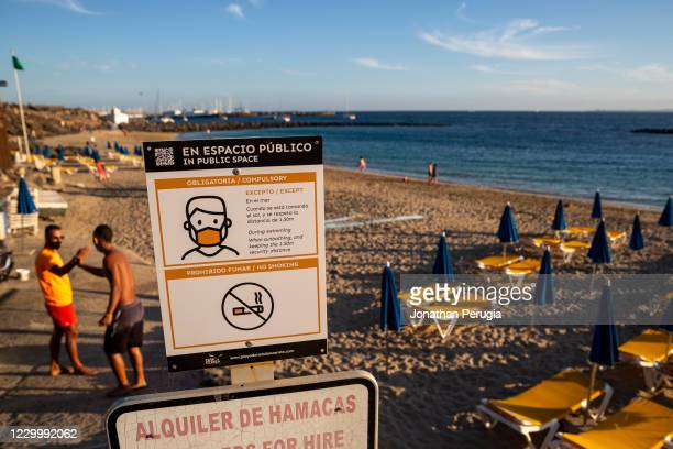Sign shows rules for wearing facemasks on the beach at Playa Dorada in Lanzarote, Spain on 22nd November 2020. Beaches and resorts across the island...