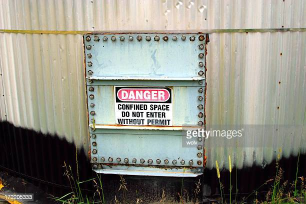 a sign shows that this place is dangerous - confined space stock pictures, royalty-free photos & images