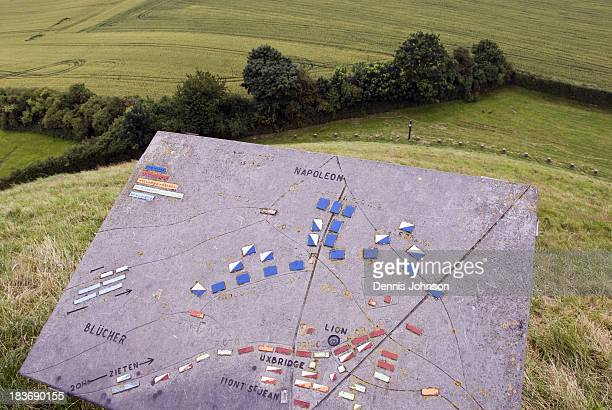 CONTENT] A sign shows the battle plan atop the Lion's Mound a large artificial hill on the Waterloo battlefield to commemorate where the Prince of...
