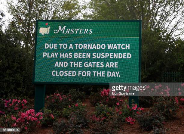 A sign shows the course is closed for the day due to inclement weather during the first day of practice for the 2017 Masters Tournament on April 3 at...