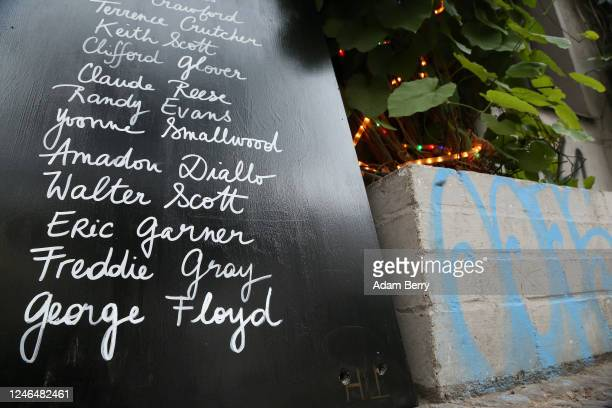 A sign shows the names of black people including most recently George Floyd who lost their lives to police brutality or white supremist attacks at...