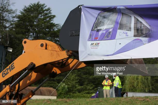 A sign shows the new train that will run on the new purple line during a groundbreaking ceremony on August 28 2017 in Hyattsville Md to build a 162...
