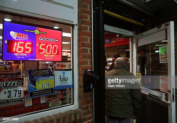 A sign shows the Powerball amount has climbed to 500 million dollars at the BP gas station January 6 2015 in Dunkirk Maryland People are...