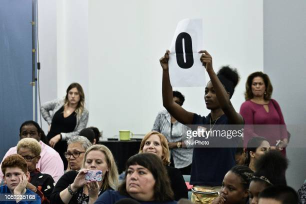 Sign signaling the candidate is out of time is held up as students ask questions to candidates for the seat of Governor incumbent Tom Wolf and Scott...
