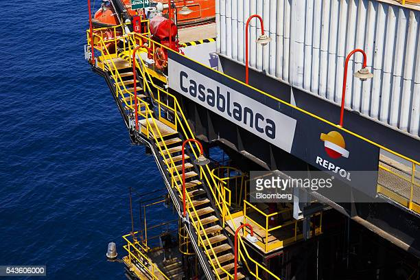 A sign sits above an access stairway on the Casablanca oil platform operated by Repsol SA in the Mediterranean Sea off the coast of Tarragona Spain...