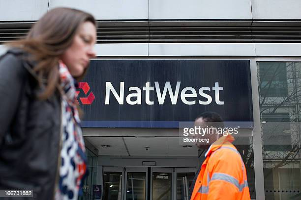 A sign sits above the entrance to a branch of NatWest bank part of the Royal Bank of Scotland Group Plc in London UK on Tuesday April 16 2013 The...