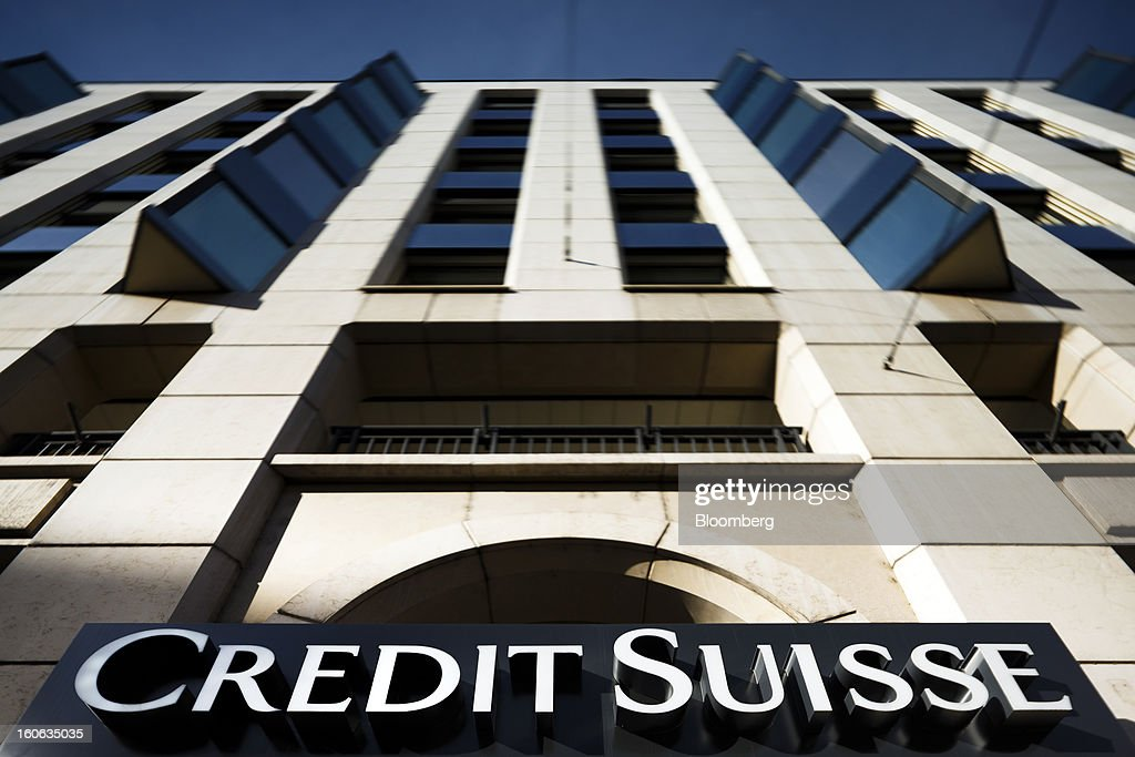 A sign sits above the entrance to a Credit Suisse Group AG bank in Geneva, Switzerland, on Sunday, Feb. 3, 2013. Credit Suisse Group AG will report fourth-quarter results for the 2012 financial year on Feb. 7. Photographer: Valentin Flauraud/Bloomberg via Getty Images