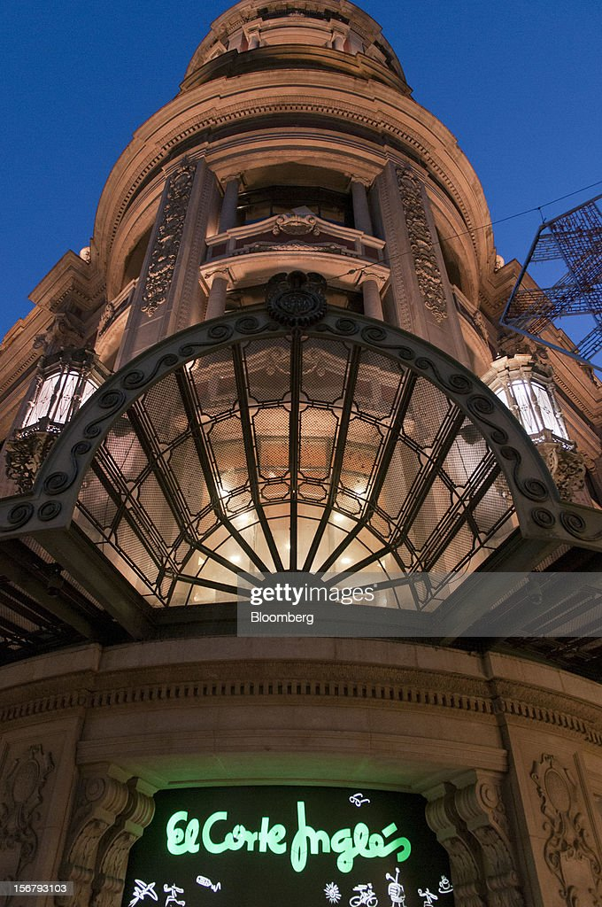 A sign sits illuminated above the entrance to the El Corte Ingles department store at Portal del Angel in Barcelona, Spain, on Tuesday, Nov. 20, 2012. Bank of Spain Governor Luis Maria Linde said the government risks missing its budget targets this year and next, adding to doubts on Prime Minister Mariano Rajoy's ability to cut the deficit amid a five-year slump. Photographer: Stefano Buonamici/Bloomberg via Getty Images