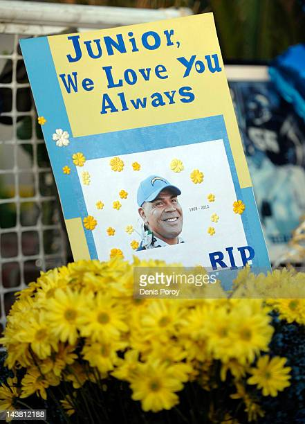 A sign sits in a bucket of flowers in driveway of former NFL star Junior Seau's house May 3 in Oceanside Calif The former football star was found...